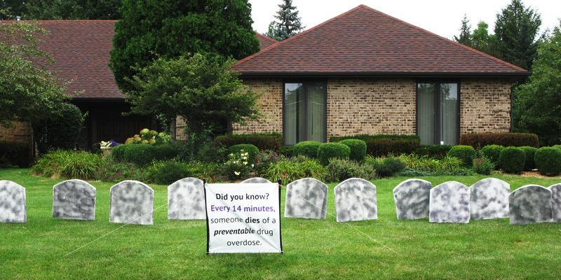 Faux tombstones line a lawn in Medinah, Ill. It's a campaign to heighten awareness about an epidemic of heroin and pain pill overdoses — a prelude to International Overdose Awareness Day on Aug. 31. Cheryl Corley/NPR